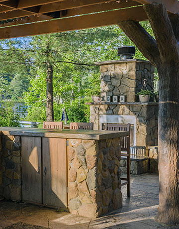 Rustic outdoor kitchen and fireplace