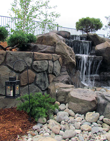 landscape lighting and waterfall