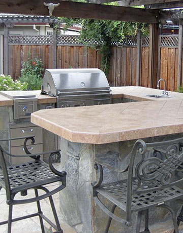 stainless steel grill and outdoor kitchen
